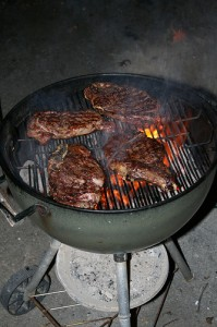 Ribeye steaks ont the grill.  Photo: WmJr via Flickr