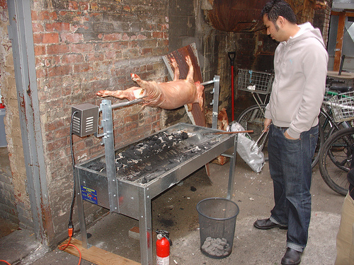 UWS restaurant Recipe roasting pig in alley.  Photo: Courtesty Westside Independent.